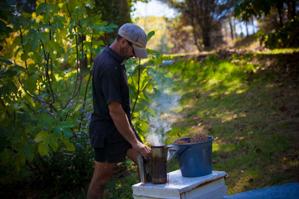 Rikki getting the smoker ready ...