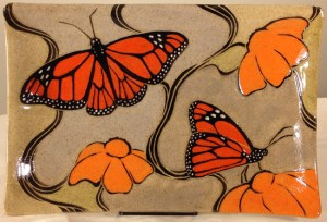 Stoneware platter, sgraffito carved monarch butterfly design