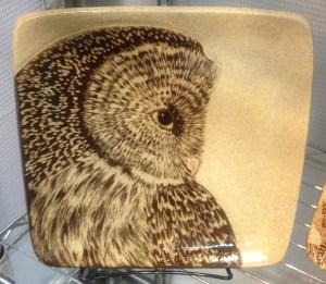 Stoneware plate, sgraffito carved owl design