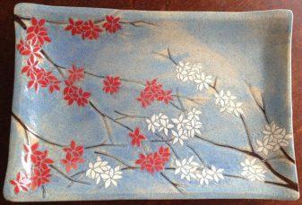 Stoneware platter, sgraffito blossoms design
