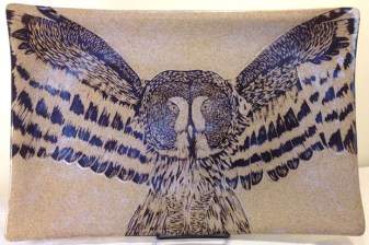 Stoneware platter, sgraffito carved great grey owl design