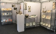 Frog Song Designs booth at Craft Vermont