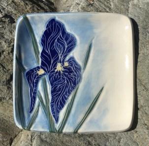 Square stoneware plate, sgraffito carved iris motif