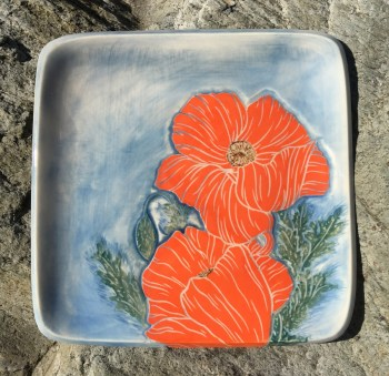 Square stoneware plate, sgraffito carved poppies design