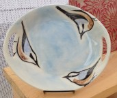 Round platter, sgraffito carved nuthatch design