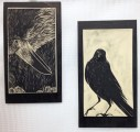 Two decorative wall tiles, sgraffito carved raven designs