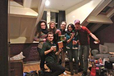 Fulbrighters showing off their gifts after a secret santa exchange (lootjes trekken)