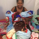 Mama Nasra and her babies with new clothes/baby items