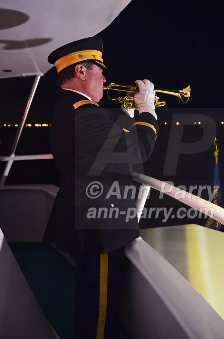 Freeport, NY, USA. 10th Sept. 2014. A bugler plays taps at night on board the boat Miss Freeport V, which sailed from the Woodcleft Canal of the Freeport Nautical Mile after a dockside remembrance ceremony in honor of victims of the terrorist attacks of September 11 2001. Ceremony was on eve of 13th anniversary of 9/11 attacks.