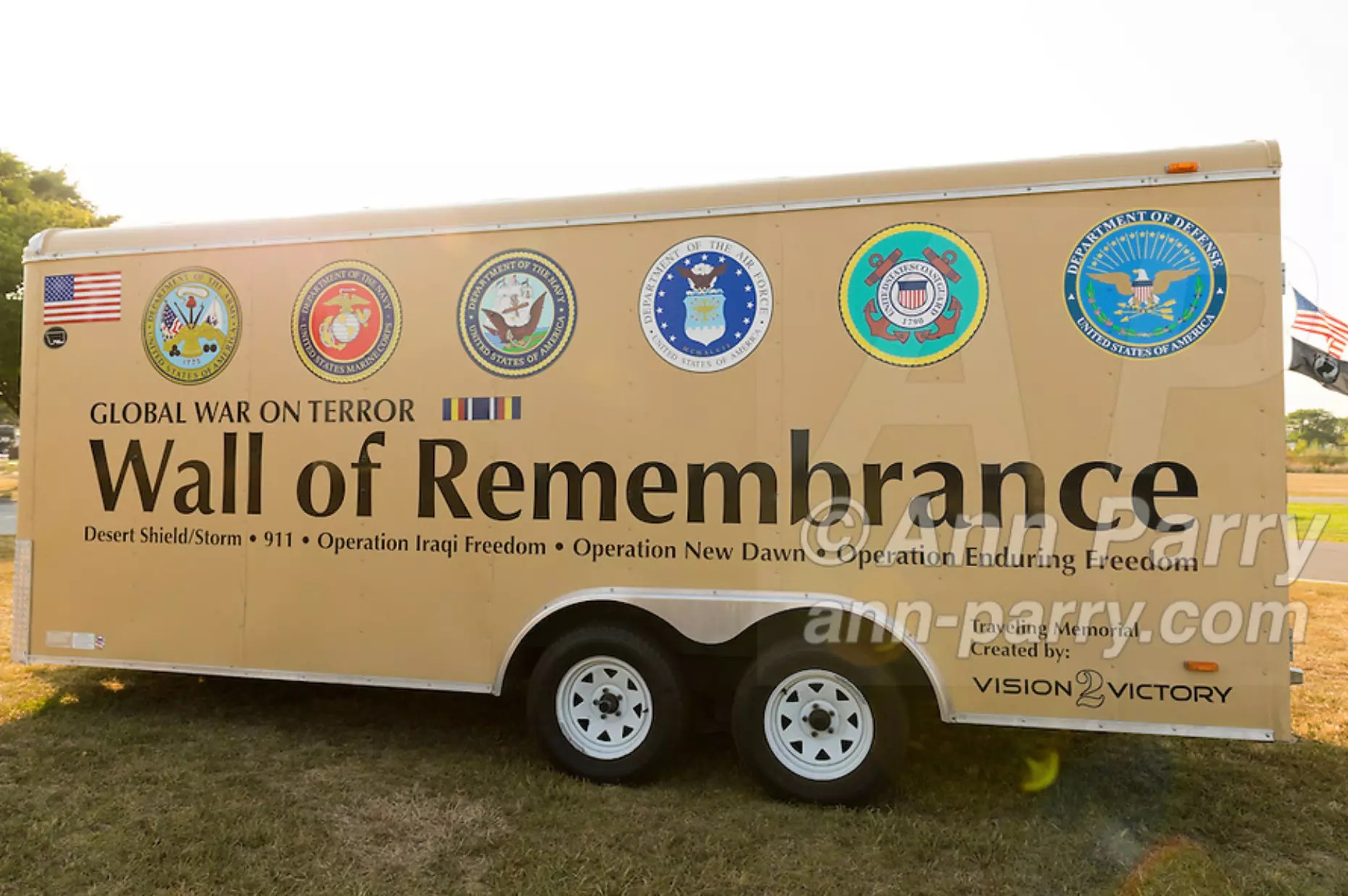 "East Meadow, NY, U.S. 11th Sept. 2013. The Wall of Remembrance trailer is by the Global War on Terror ""Wall of Remembrance"" a traveling memorial on display in New York for the first time, at Eisenhower Park on the 12th Anniversary of the terrorist attacks of 9/11. The unique 94 feet long by 6 feet high wall has, on one side, almost 11,000 names of those lost on September 11, 2001, along with heroes and veterans who lost their lives defending freedom of Americans over past 30 years. On the wall's other side is a timeline, with photos, covering 1983 to present day."