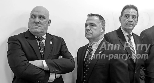 Mineola, NY, USA. March 5, 2012. At Nassau County Legislature meeting when legislators vote to confirm Thomas Dale as Police Commissioner and to consolidate 8 police precincts into 4, are, L-R, Nassau PBA President JAMES CARVER, PBA's Sergeant-at-arms JAMES McDERMOTT, and President of Superior Officers (SOA) GARY LEARNED.