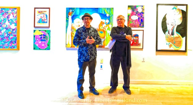 Huntington, NY, USA. March 29, 2019. L-R, Juror Benjamin Owens and Huntington Arts Council Executive Director Marc Courtade address visitors during HAC Opening Reception for Bright Colors Bold Strokes, Creations of Lowbrow Art Exhibition.