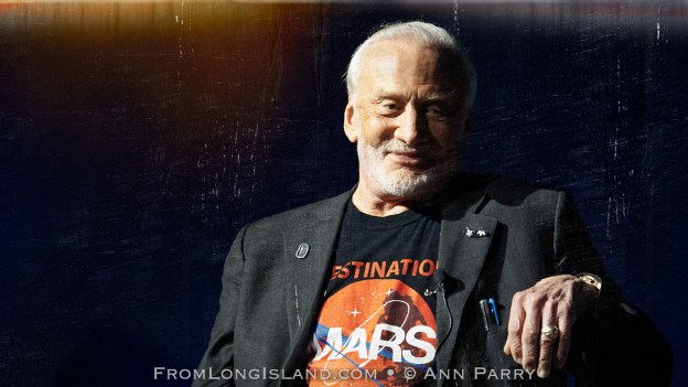 Garden City, New York, U.S. October 23, 2015. Former NASA astronaut Edwin BUZZ ALDRIN is in conversation about his experiences in space and his new Children's Middle Grade book Welcome to Mars: Making a Home on the Red Planet, at Long Island's Cradle of Aviation Museum, Aldrin signed copies of his new book. (grunge filter) © 2015 Ann Parry, Ann-Parry.com