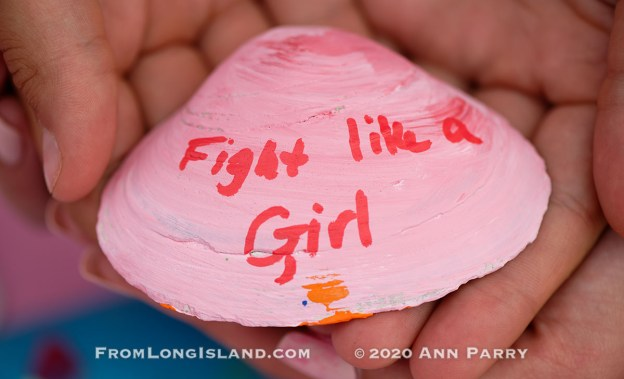 (© 2020 Ann Parry, FromLongIsland.com) Merrick, New York, U.S. August 15, 2020. ANNIE FITZPATRICK, 12-years-old, and friends hold a pink shell with Fight like a Girl written on it. Lizzie's Army painted shells to sell to raise funds to donate to American Cancer Society Making Strides Against Breast Cancer. Annie's 24 year old sister Lizzie was diagnosed with Triple Negative Breast Cancer in late June . Over $3,000 has been raised so far through shell sales and GoFundMe.