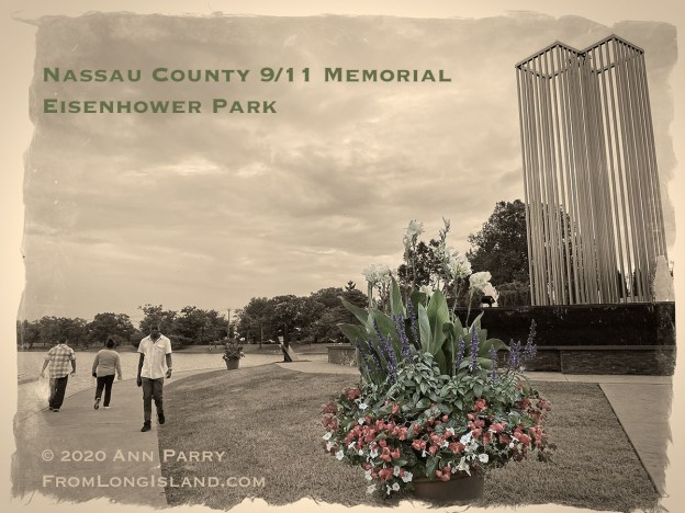 East Meadow, New York, U.S. September 10, 2020. The Nassau County 9/11 Memorial includes a tall metal sculpture representing the Twin Tower, two pieces of beams from the original Twin Towers, and a Survivor Tree. Because of rain prediction, the 19th anniversary of September 11 terrorist attacks with Remembrance and Name Recitation Ceremony was held at Harry Chapin Theater across the pond in Eisenhower Park. (© 2020 Ann Parry, AnnParry.com)