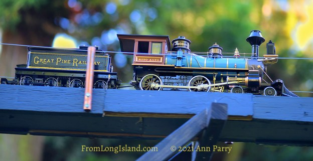 Old Westbury, New York, U.S. June 23, 2021. Long Island Railroad model trains, a large G gauge, travel outdoors during the Old Westbury Gardens opening reception for its Great Pine Railway exhibit, which includes Long Island landmarks and runs until September 6. (© 2021 Ann Parry, FromLongIsland.com)