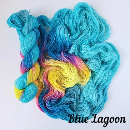'Blue Lagoon' colorway, there is a skein on the left and an opened up skein on the right that shows how the colors flow into each other. text on the right bottom corner specifies the colorway name.