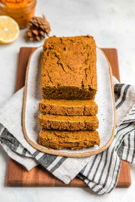 loaf of pumpkin bread on wood serving tray