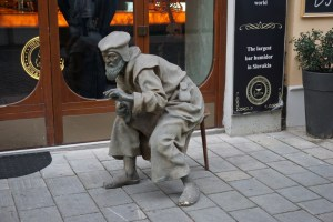 Sculptures in Bratislava - man on a chair