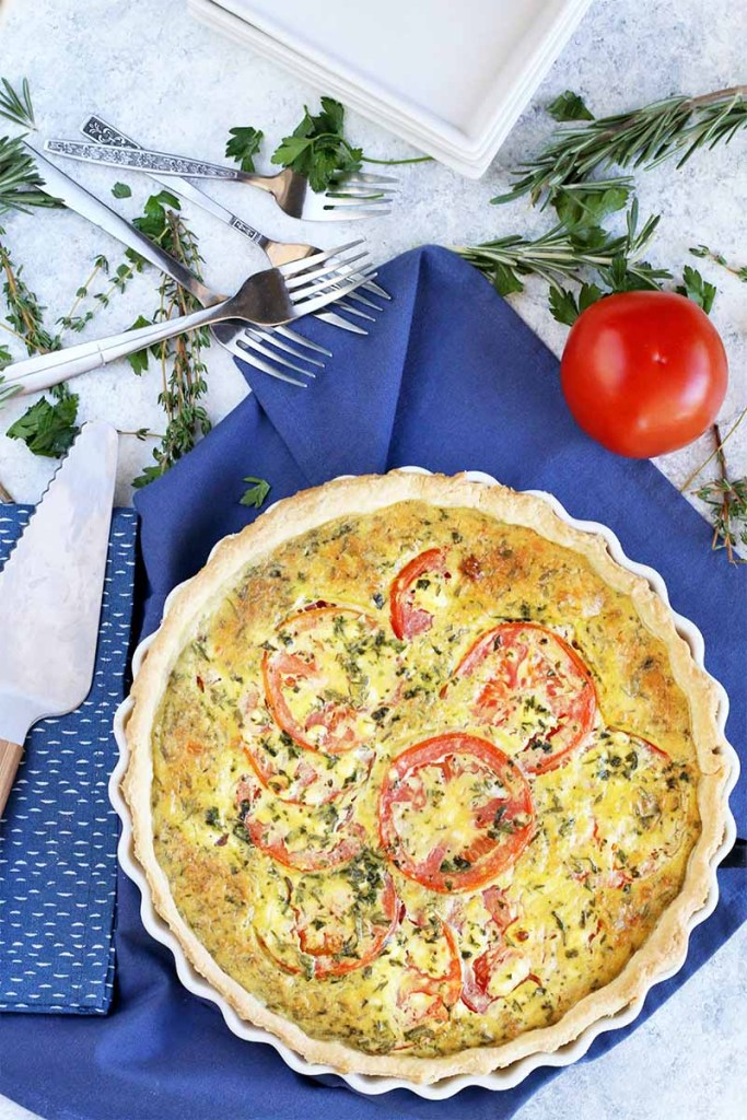 Fresh tomato and egg tart with goat cheese and herbs