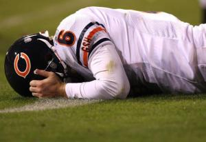 SAN FRANCISCO - NOVEMBER 12: Jay Cutler #6 of the Chicago Bears lies on the grass against the San Francisco 49ers at Candlestick Park on November 12, 2009 in San Francisco, California. The 49ers won 10-6. (Photo by Jed Jacobsohn/Getty Images)