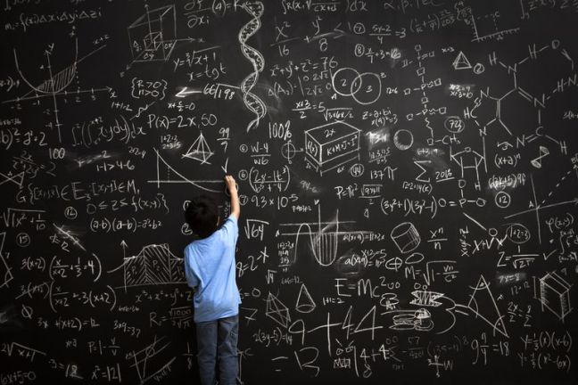 young-boy-writes-math-equations-on-chalkboard-168351254-5ad90020ba61770036501446