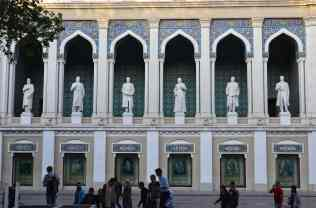 Statues of famous Azeri authors and poets tucked into arched niches.