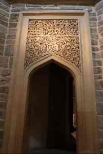 A renovated door inside the main palace complex.