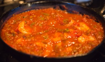 Shrimp have been added to the sauce and cooked for just a few minutes until they have become pink and lost their translucence