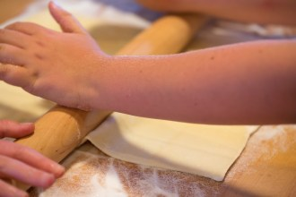 Rolling out the puff pastry on a bed of granulated sugar