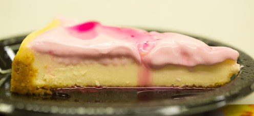 Cheesecake with prickly pear topping and a drizzle of syrup