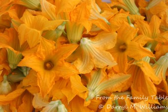 A basket of squash blossoms at the farmers market