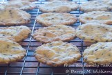 Baked benne wafers cooling on a rack