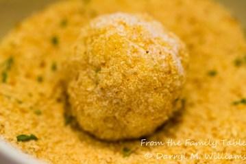 Arancino rolled in fine bread crumbs