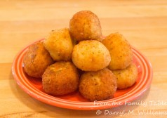 A plate of arancini ready to be eaten