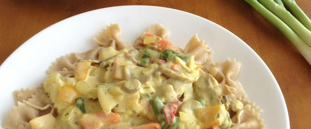 Bow tie pasta with chopped red, yellow orange peppers, mushrooms and asparagus