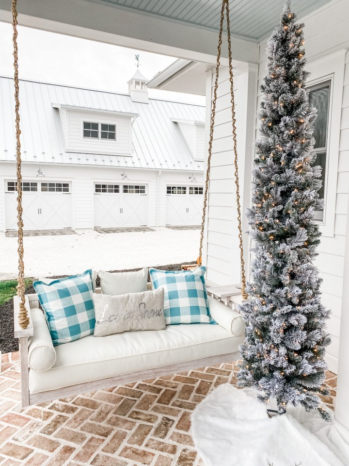 front porch swing with Christmas Decorations