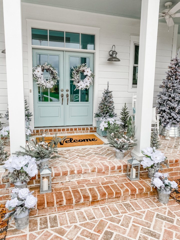 Front door and steps with Christmas decor