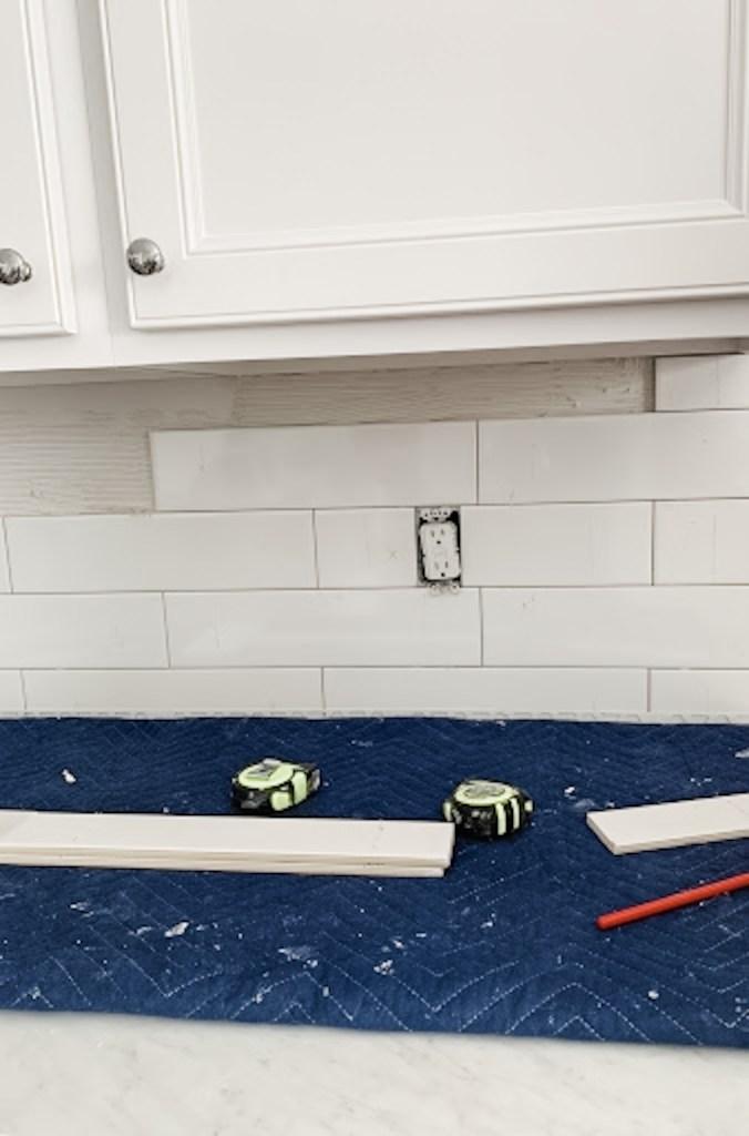 "4"" x 16"" White Subway Tile kitchen backsplash in progress"
