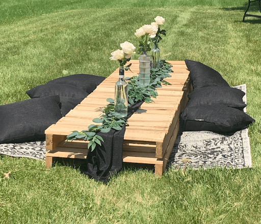 Flowers on a pallet picnic table
