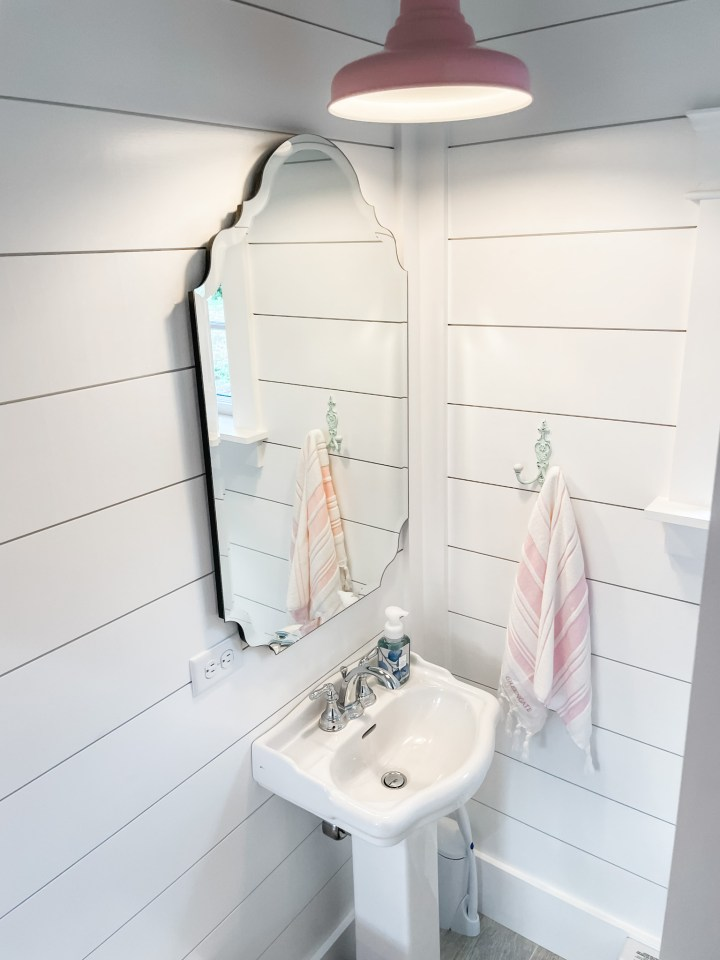 pool house bathroom mirror and sink