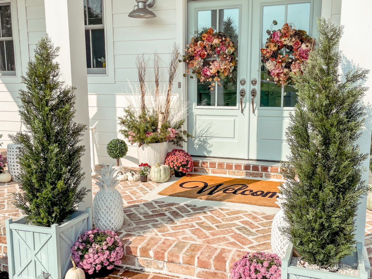 fall front porch with a blue front door