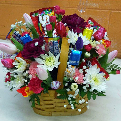 As Sweet As You - A basket of mixed spring flowers and candy