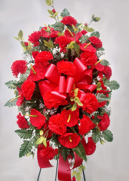SIlk spray of carnations and tropical flowers