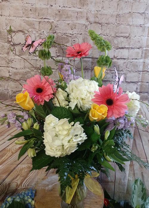gerbera daisies, hydrangeas, roses, stock, bells of ireland