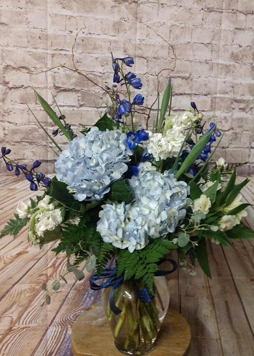 blue hydrangeas, blue delphinium, iris and alstromeria