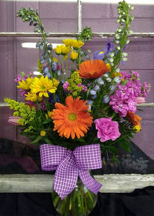 Color Me Happy bouquet of colorful spring flowers in vase starting at $35.00