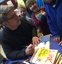 Peter signs Stink and the Attack of the Slime Mold for fans