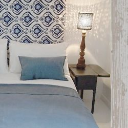 Le Mas des Oules, a holiday rental in Provence with several houses to rent. Master bedroom in blue tones in the Belle house, a holiday rental, near Uzes, France.