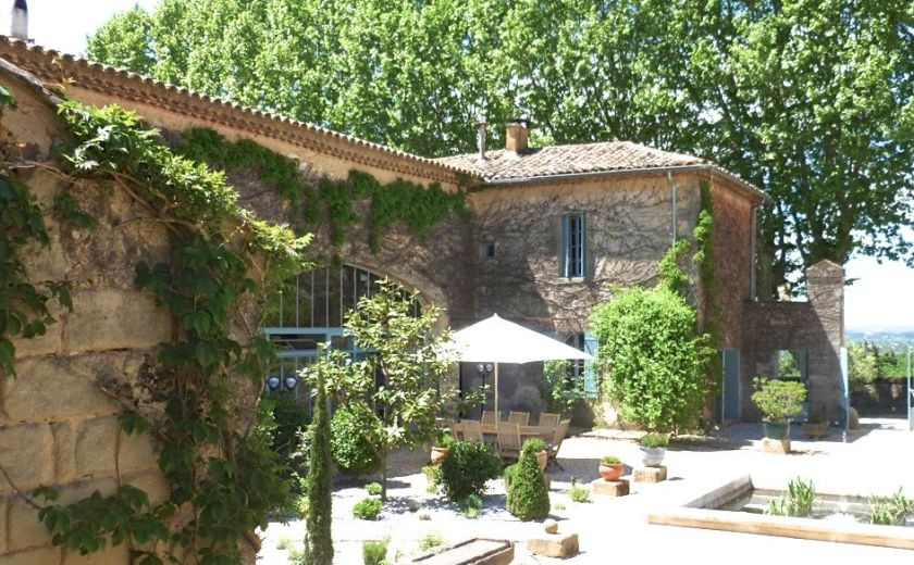 "Le Mas des Oules, a holiday rental in Provence with several houses to rent.  The courtyard with lovely trees, ""bassins"" and tables to enjoy lunch outside."
